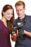Photographer showing model images Stock Photo
