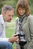 Photographer showing pictures Royalty Free Stock Photography