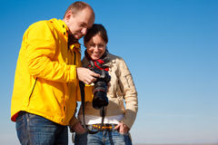 Photographer shows camera shot girl Royalty Free Stock Image