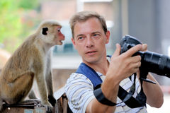 Photographer shows a monkey Stock Images