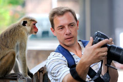 Photographer shows a monkey photo shoot Royalty Free Stock Photography