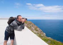 Photographer sightseeing and photographing a beautiful coastal l Stock Photography
