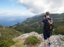 Photographer sightseeing and photographing a beautiful coastal l Stock Images