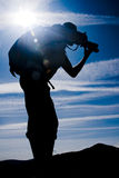 Photographer silhouette. Against sunny sky Stock Images