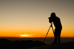 Photographer silhouette. In outdoor with dramatic sunset Stock Photo