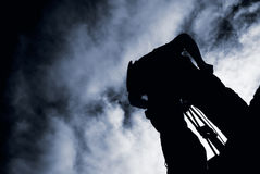 Photographer silhouette. Stand with dramatic clouds and working Royalty Free Stock Photography