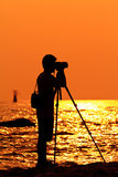 Photographer silhouette. Shooting sea outdoors Royalty Free Stock Photo