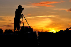 Photographer silhouette. Silhouette of a photographer shooting sunset scene Stock Photography