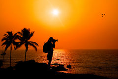 Photographer Silhouette At Sunset Stock Image