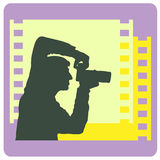 Photographer. Silhouette of the photographer on the background of the film. Emblem Royalty Free Stock Photography