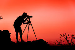 Photographer silhouette. Photographer background scene Stock Images