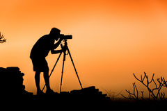 Photographer silhouette. Photographer background scene Royalty Free Stock Photos