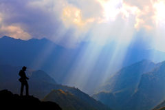 Photographer silhouette. Beautiful Sunlight Rays on mountain with Landscape Photographer, Copyspace royalty free stock photos