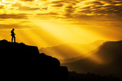 Photographer silhouette. Beautiful Sunlight Rays on mountain with Landscape Photographer, Copyspace royalty free stock photography