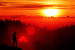 Photographer silhouette. Beautiful Sunlight when sunrise on mountain with Landscape Photographer, Copyspace royalty free stock images