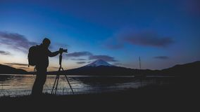 Photographer Silhouette With Fuji Mountain. A Photographer Silhouette With Stunning Lake Fuji Mountain View Background royalty free stock images