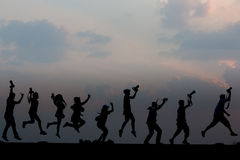 Photographer silhouette. The gang  jumping photographer silhouette Royalty Free Stock Images