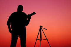 The Photographer' Silhouette with his tripod Stock Photography