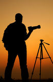 The Photographer' Silhouette with his tripod Stock Photo