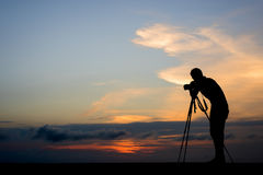 Photographer silhouette in outdoor. With dramatic sunset Stock Image