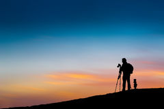 Photographer in silhouette Stock Photos