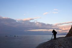Photographer silhouette on a sea coast Royalty Free Stock Photography