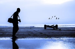 Photographer silhouette shooting near the beach. When sun rising Royalty Free Stock Photos