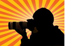 Photographer silhouette with sunburst. As background Stock Photo