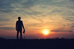 Photographer silhouette in the sunset Stock Photography