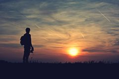 Photographer silhouette in the sunset Stock Image
