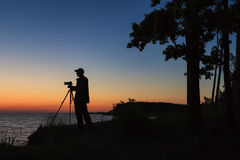 Photographer silhouette at sunset. Sky Royalty Free Stock Photo