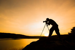 Photographer silhouette. With sunset or sunrise Stock Photography