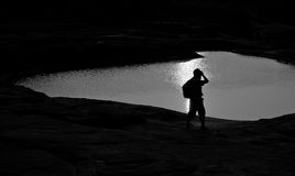 Photographer silhouette. Silhouette of photographer taking picture of landscape during sunrise Royalty Free Stock Photography