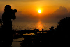 Photographer silhouette at the viewpoint. With dramatic sunset Stock Photos