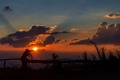 Photographer silhouetted Stock Photography