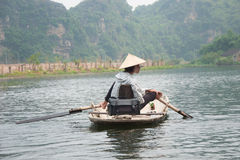 Photographer Sitting in a Boat Royalty Free Stock Photography