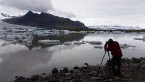 Photographer on Skaftafell Glacier lagoon Iceland stock photos