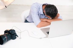 Photographer sleeping at his workplace Royalty Free Stock Photo