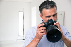 Photographer sleeping at his workplace Royalty Free Stock Images