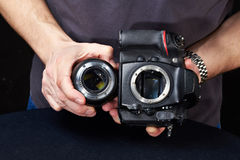 Photographer with SLR camera without lens Royalty Free Stock Photo