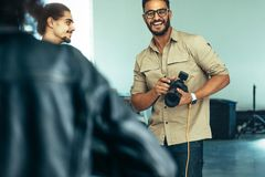 Photographer smiling during a photo shoot royalty free stock photos