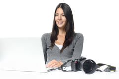 Photographer smiling in satisfaction at her images Stock Photo