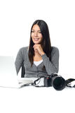 Photographer smiling in satisfaction at her images Royalty Free Stock Photo
