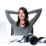 Photographer smiling in satisfaction at her images Royalty Free Stock Images