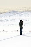 Photographer in the snow Royalty Free Stock Photography