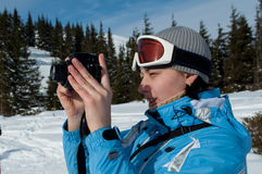 Photographer in snow mountains Stock Photos