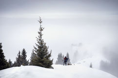 Photographer in the snowy mountains Royalty Free Stock Images