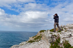 Photographer in South Africa. Photographer making picture of beautiful Dias beach and nature, Cape of Good Hope, South Africa royalty free stock photos