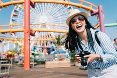 Photographer standing in amusement park and stock photo