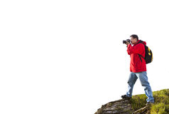 Photographer standing on the  mountain isolated on white Royalty Free Stock Images